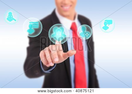 business man hand pressing social network icon on a virtual background