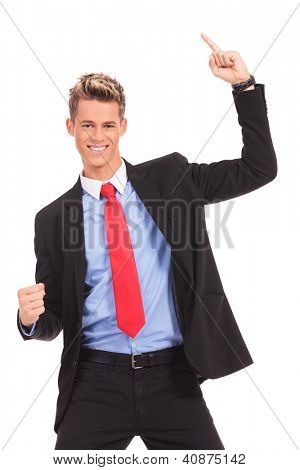 Portrait of young businessman  with his arms widened winning