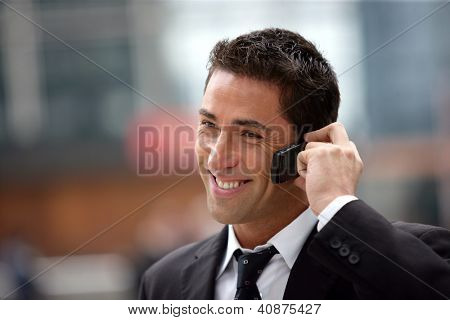 handsome businessman having phone call