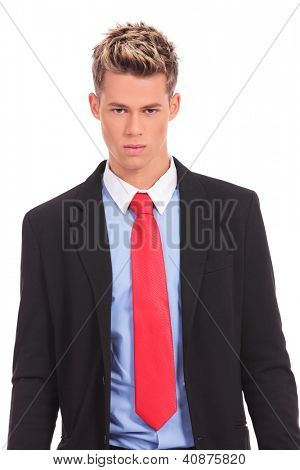 Serious executive in suit posing on white background
