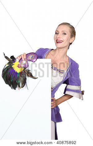 Blond woman in fancy dress outfit