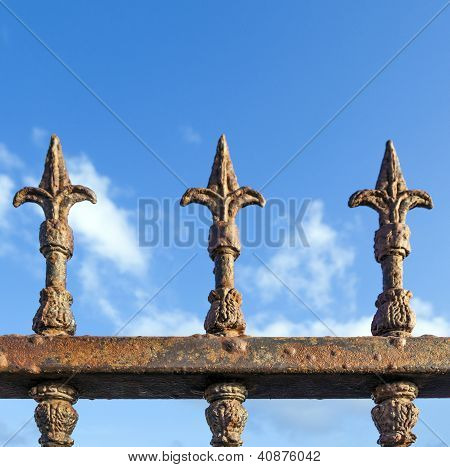 Rusty Fence Under Blue Sky
