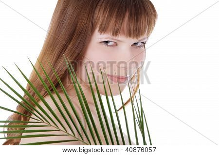 Pretty Face Of Woman Hiding Behind The Big Green Palm Leaf