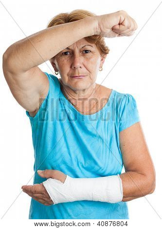 Elderly hispanic woman with a broken arm defending herself against an aggressor (isolated on white)