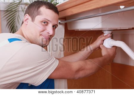 Plumber screwing siphon