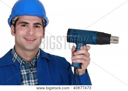 male worker and an electric screwdriver