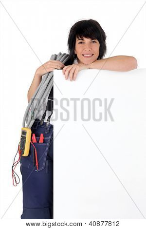 Electrician with a board left blank for your message