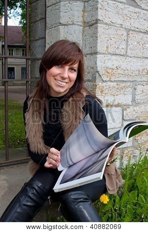 Girl With Photo Book
