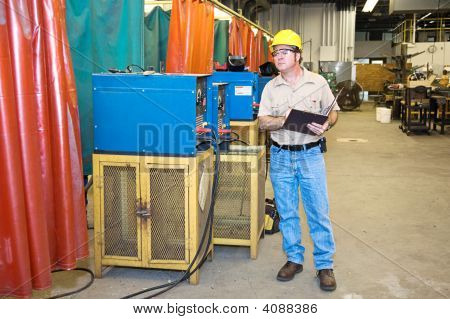 Inspector On Factory Floor