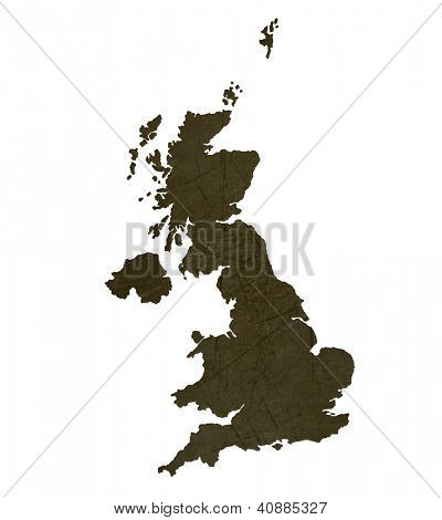 Dark silhouetted and textured map of United Kingdom isolated on white background.