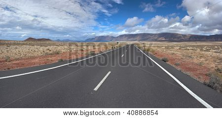 Panorama Of The Empty Road Through Sandy And Volcanic Desert, Canary Islands.