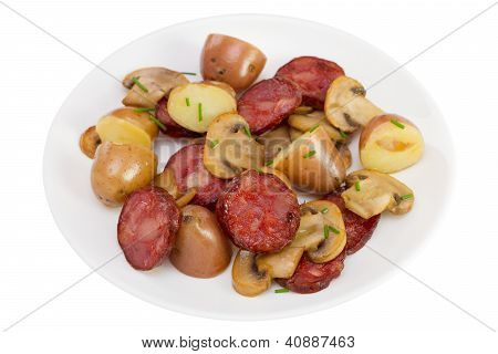Salad With Sausages On The Plate On White Background