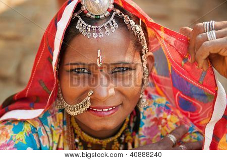 Beautiful Traditional Indian woman in sari costume covered her head with veil, India