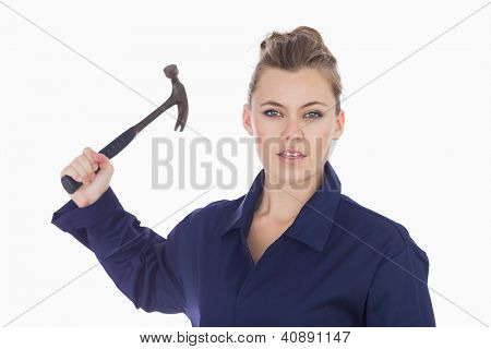 Portrait of young female technician holding claw hammer against white background