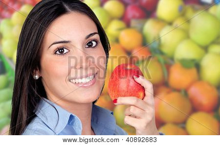 Beautiful girl with a red apple in the grocery