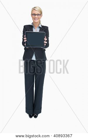 Smiling businesswoman standing while holding tablet pc