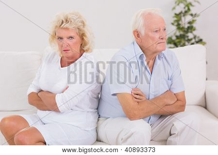 Elderly woman being angry against a man on the sofa