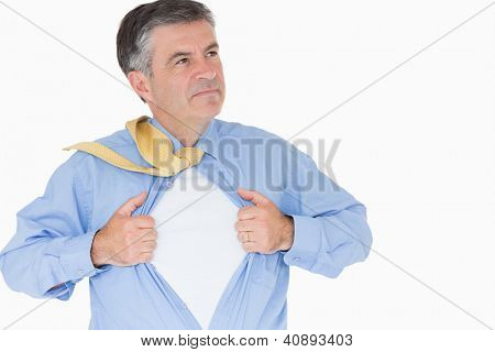 Serious man pulling his shirt with his hands like a superhero