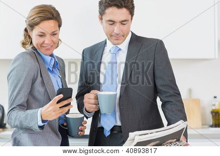Couple having coffee before work in kitchen