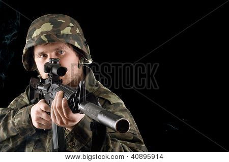 Man Keeping A Gun In Studio