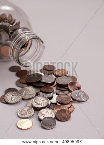 Coins Spilled Out On A Table Top.