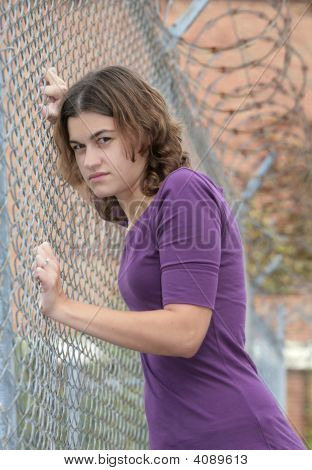 Woman Against Fence