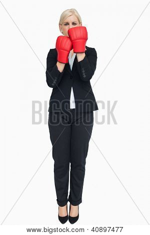 Blonde businesswoman with red gloves against white background