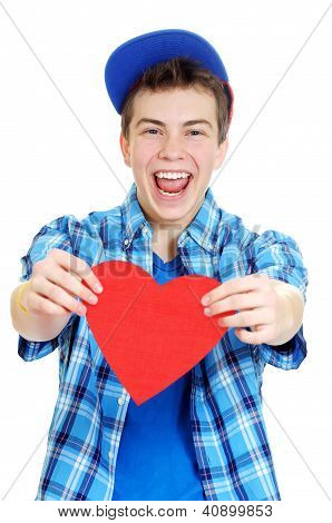 Smiling Teenage Boy Holding Valentine Heart Cut Out From Red Paper Over White Background