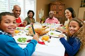 stock photo of turkey dinner  - Multi Generation Family Celebrating Thanksgiving - JPG