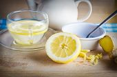picture of home remedy  - Kitchen preparation scene containing ingredients for a honey lemon and ginger drink  - JPG