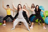 foto of health center  - Group training in a gym of a fitness center - JPG