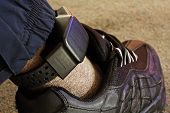 stock photo of social housing  - Security electronic tag on a tagged criminal - JPG