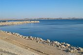 stock photo of aswan dam  - Lake Nasser artificial water storage view from Aswan Dam Egypt - JPG