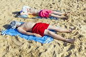 image of papagayo  - brothers relax and sleep at the beach - JPG
