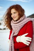 stock photo of gril  - Beautiful gril with the curly hair in the snow country - JPG