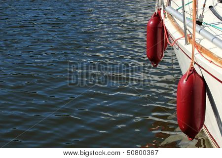 Yachting. Parts Of Yacht Maritime Red Fenders