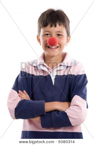 Portrait Of An Adorable Child With A Clown Nose