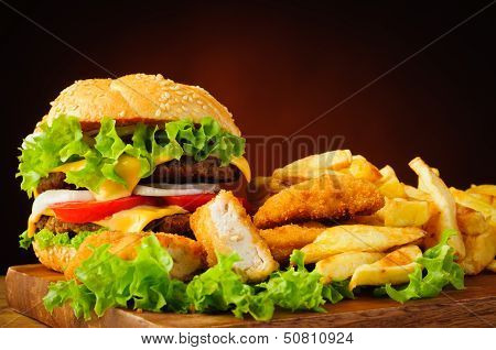 Cheeseburger, Fried Chicken Nuggets And French Fries