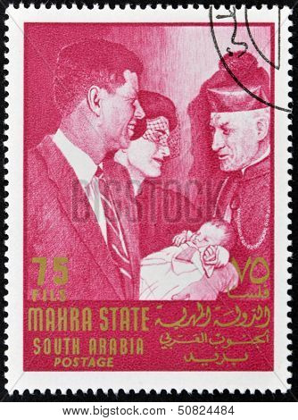 stamp printed by South Arabia shows John Fitzgerald Kennedy and Jacqueline