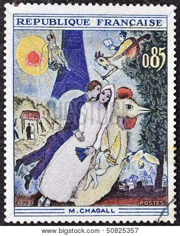 A stamp printed in France shows the work The Bride and Groom of the Eiffel Tower by Marc Chagall