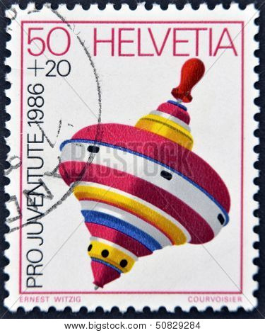 Switzerland - Circa 1986: A Stamp Printed In Switzerland Shows A Peg-top, Circa 1986