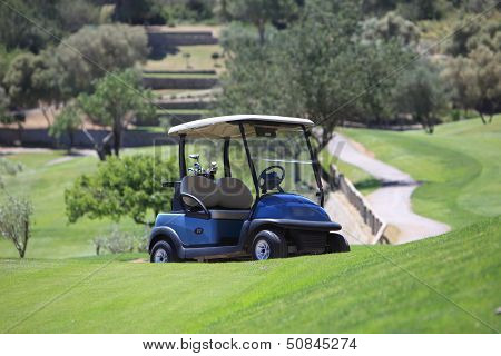 Golf Cart Parked On A Golf Course