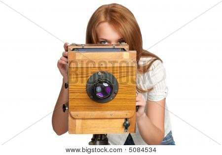 Woman Taking Photoes With Vintage Camera