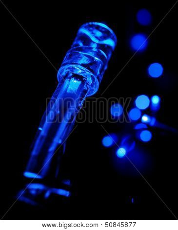 Closeup Photo Of Blue Led (light Emitting Diodes) Lights Garland On Black Background