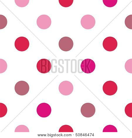 Seamless vector pattern with big colorful pink and red polka dots on white background