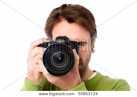 Closeup Portrait Of A Young Man Taking A Picture