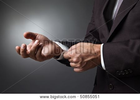 Close-up of elegance man hands with cufflink