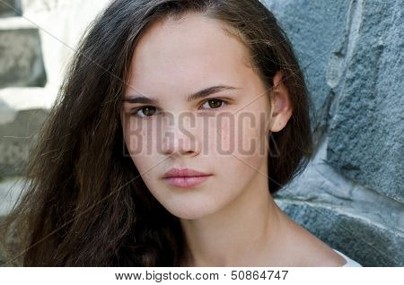 Portrait of a beautiful young freckled girl.