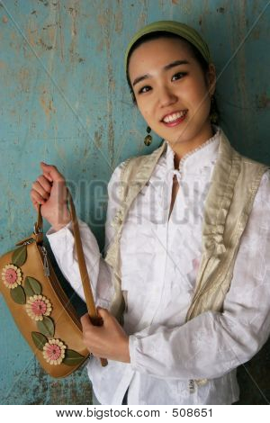 Asian Woman Holding A Handbag