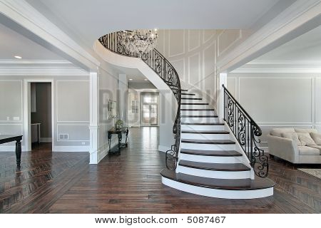 Foyer With Curved Stairway